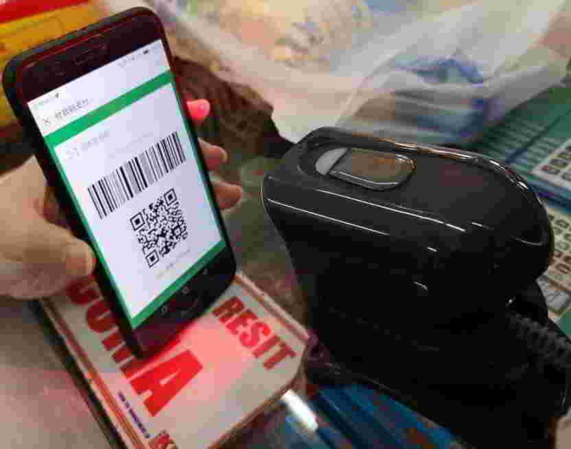 手机屏幕对准微信支付二维码扫描仪扫描