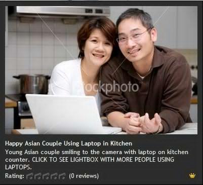 Happy Asian Couple Using Laptp in Kitchen 幸福的亚洲夫妇在厨房里使用笔记本